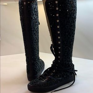 Authentic Chanel. leather laser Cut sneaker boots